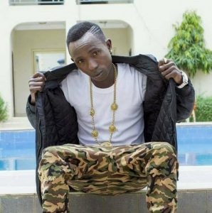 Fan threatens to beat Patapaa.